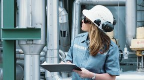 Female engineer in factory, CO2 treatment unit at an environmental project at the Kwinana site, Western Australia.